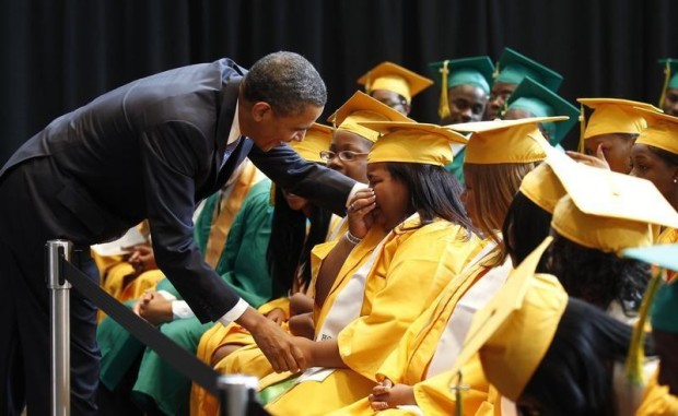 U.S. President Barack Obama comforts a student overcome with emotion after speaking with the graduating class from Booker T. Washington High School in Memphis