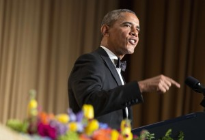 U.S. President Barack Obama makes a joke as he speaks during the White House Correspondents' Association Dinner