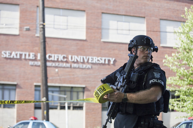 A policeman secures the scene at Seattle Pacific University after the campus was evacuated due to a shooting in Seattle, Washington