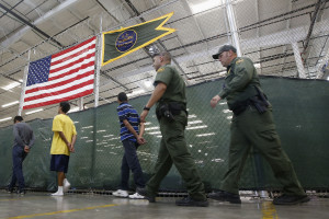 Detainees are escorted to an area to make phone calls as hundreds of mostly Central American immigrant children are being processed and held at the U.S. Customs and Border Protection (CBP) Nogales Placement Center in Nogales, Arizona