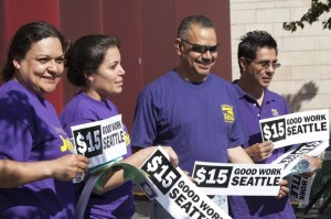 Labor activists celebrate during a rally at Seattle City Hall after a Seattle City Council meeting
