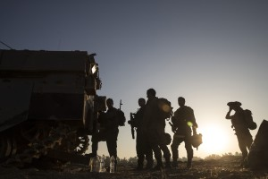 Israeli soldiers stand near the border with Gaza