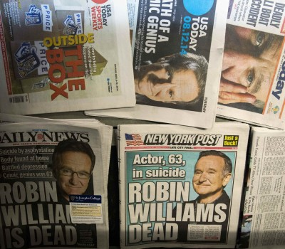 Newspapers announcing the death of Williams are stacked on a newsstand in New York