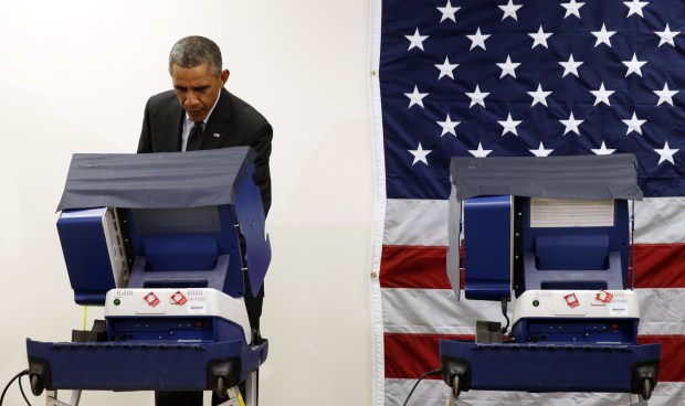 U.S. President Barack Obama takes part in early voting at a polling station in Chicago