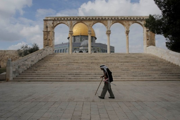 A Palestinian walks in front of the Dome of the Rock in Jerusalem's Old City