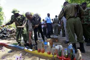 Police display improvised petrol bombs at the Bamburi police station, which were found when they raided Masjid Swafaa mosque in the Kisauni area of Mombasa