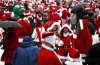 Revelers dressed as Santa Claus gather at a park during the SantaCon event in New York