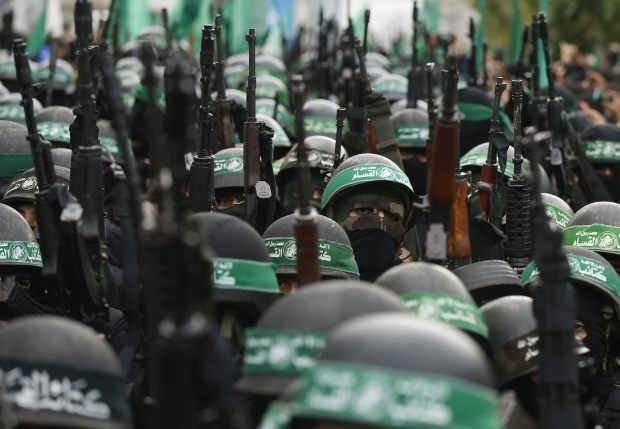 Palestinian members of al-Qassam Brigades take part in a military parade in Gaza City