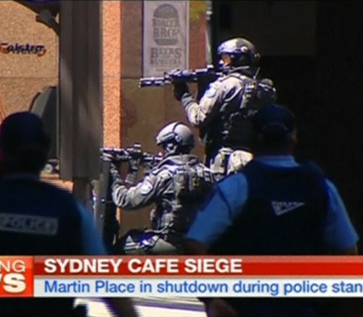 Video grab shows armed police taking up position near Sydney's Lindt cafe, where hostages are being held