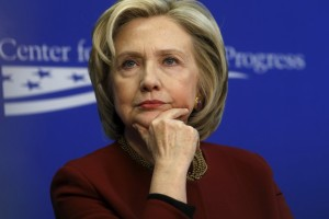 """Clinton listens to remarks as she takes part in a Center for American Progress roundtable discussion on """"Expanding Opportunities in America's Urban Areas"""" in Washington"""