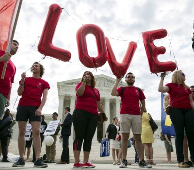 Supporters of gay marriage rally in front of the Supreme Court in Washington June 25, 2015.  REUTERS/Joshua Roberts