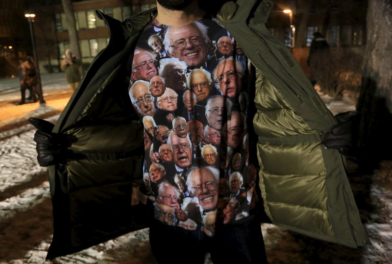 A supporter for U.S. presidential Democratic candidate Bernie Sanders shows his t-shirt before a U.S. Democratic presidential candidates debate in Milwaukee, Wisconsin, United States February 11, 2016. REUTERS/Darren Hauck