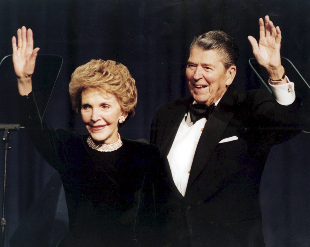 Former U.S. President Ronald Reagan and his wife Nancy wave while attending a gala celebrating his 83rd birthday in Washington in this  February 3, 1994 file photo. REUTERS/Mike Theiler/Files