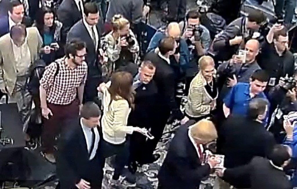 Republican Presidential candidate Donald Trump's campaign manager Corey Lewandowski (C) is seen allegedly grabbing the arm of reporter Michelle Fields in this still frame from video taken March 8, 2016 and released by the Jupiter (Florida) Police Department March 29, 2016.  REUTERS/Jupiter Police Department/Handout via Reuters