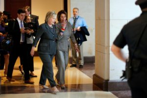 Democratic U.S. presidential candidate Hillary Clinton (L) and U.S. House Minority Leader Nancy Pelosi (D-CA) leave a House Democratic Caucus meeting on Capitol Hill in Washington, U.S., June 22, 2016. REUTERS/Carlos Barria