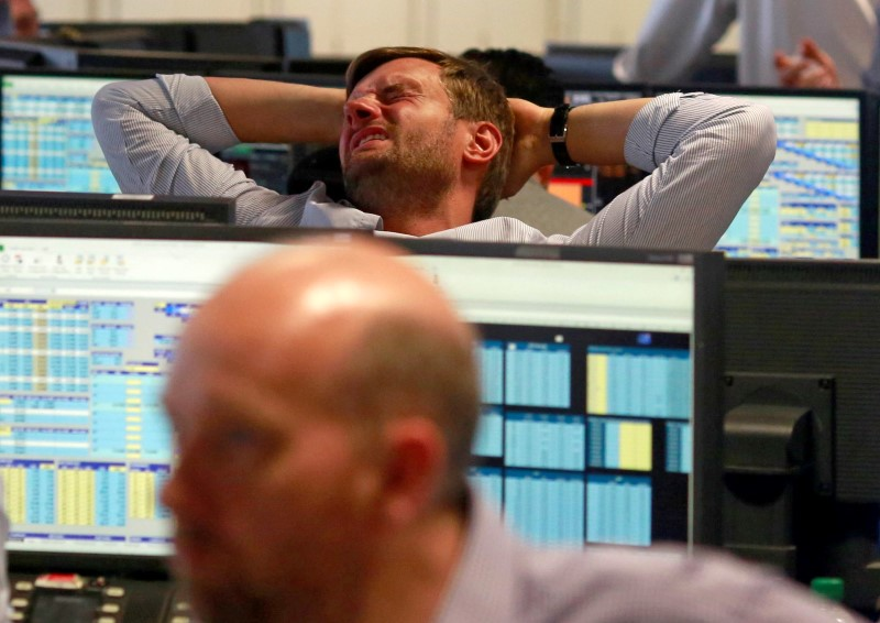 A trader from BGC, a global brokerage company in London's Canary Wharf financial centre reacts during trading June 24, 2016 after Britain voted to leave the European Union in the EU BREXIT referendum.    REUTERS/Russell Boyce - RTX2HYGZ