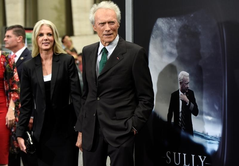 "Director Clint Eastwood and girlfriend Christina Sandera attend the New York premiere of the film ""Sully"" in Manhattan, New York, U.S., September 6, 2016. REUTERS/Darren Ornitz"