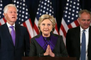 Democratic presidential candidate Hillary Clinton, with her husband, former U.S. President Bill Clinton, (L), and her Vice-President running mate Tim Kaiine (R), listen to  her concession speech to President-elect Donald Trump in New York, U.S., November 9, 2016.        REUTERS/Carlos Barria