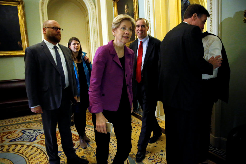 U.S. Senator Elizabeth Warren (D-MA) (3rd L), trailed by U.S. Senator Jeff Merkley (D-OR) (3rd R), arrives for Senate Democratic party leadership elections at the U.S. Capitol in Washington, DC, U.S. November 16, 2016. REUTERS/Jonathan Ernst