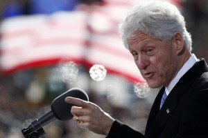 Former U.S. President Bill Clinton speaks to a crowd at a campaign event in New Hampshire