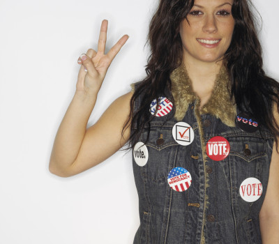 Patriotic woman giving peace sign