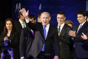 Israel's Prime Minister Netanyahu waves to supporters at the Likud-Yisrael Beitenu headquarters in Tel Aviv