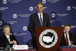 Holder, flanked by Parker and Pistole, delivers remarks on gun violence to the U.S. Conference of Mayors winter meeting in Washington