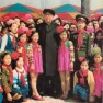 The great leader President Kim Il Sung poses with lovely children, embracing the children who enjoy themselves at amusement facilities in the newly-built Mangyongdae Fun Fair (April 6, 1982)