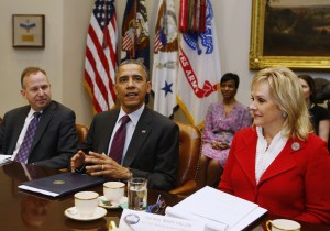 U.S. President Obama sits with members of the National Governors Association Executive Committee in Washington