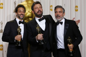 "Producers of best picture winner ""Argo"" Heslov, Affleck and Clooney pose with their Oscars at the 85th Academy Awards in Hollywood, California"