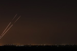 Rockets streaks are seen in the night sky after they are launched from the northern Gaza Strip towards Israel